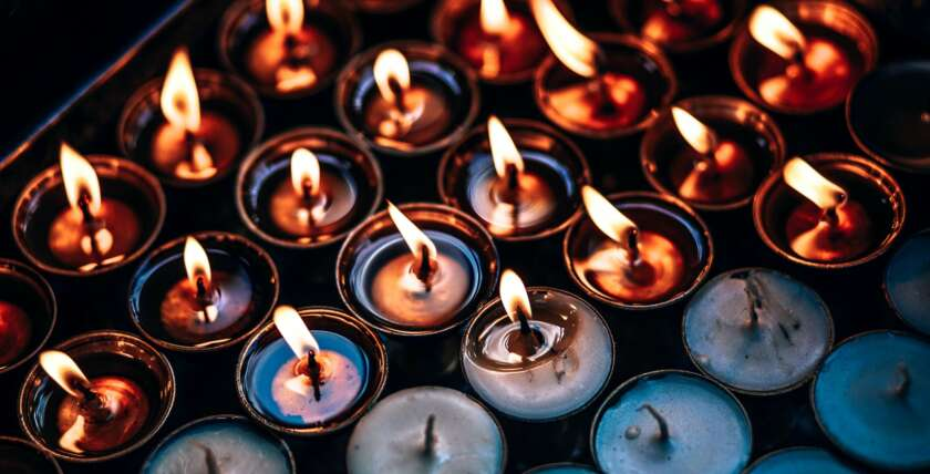 Burning Prayer Candles